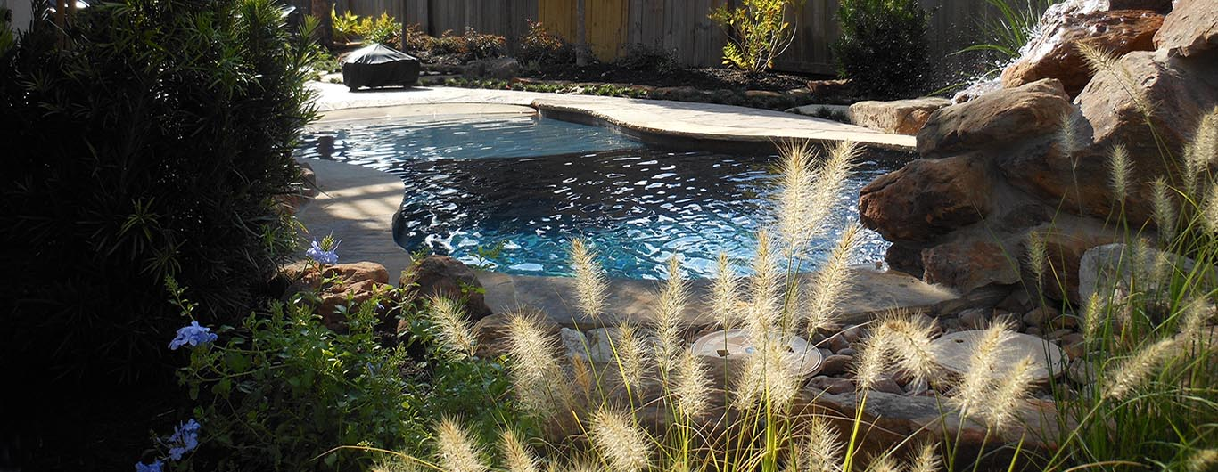 Waterfalls, ponds, creekbeds, rocks, urns, waterscapes, YardBirds Landscape Design and Installation Services.